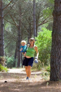 2240626-young-mother-carrying-her-toddler-son-and-walking-through-woods-on-a-sunny-day1